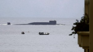 In this Aug. 28, 2014 photo, fishermen look at a Chinese nuclear submarine sails past...